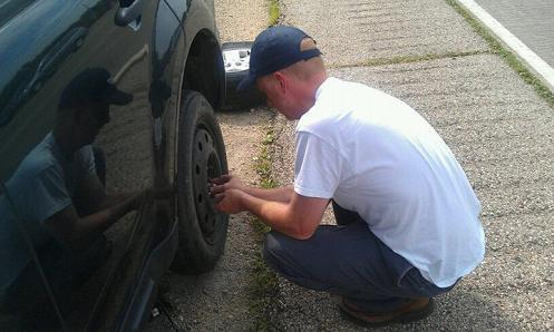 Fred Clark changes a tire