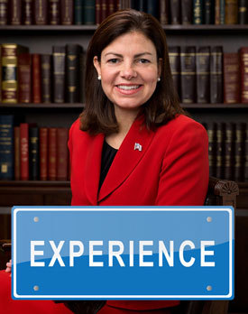 Official photo of Kelly Ayotte with superimposed sign reading 'Experienced'