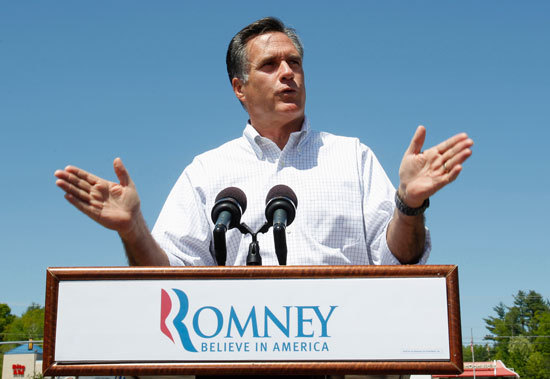 Mitt Romney at podium with hands extended in both directions