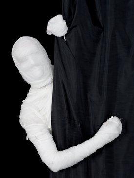 mummy behind curtain