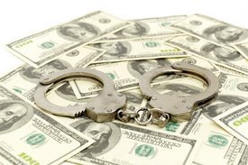 handcuffs on money