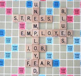 unemployment on Scrabble board