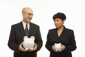 man holding big piggybank, woman holding small one