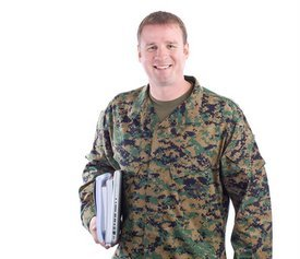 military man holding schoolbooks
