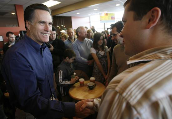 U.S. Republican presidential candidate and former Massachusetts Governor Mitt Romney shakes hands with a supporter as he campaigns in Altoona Iowa