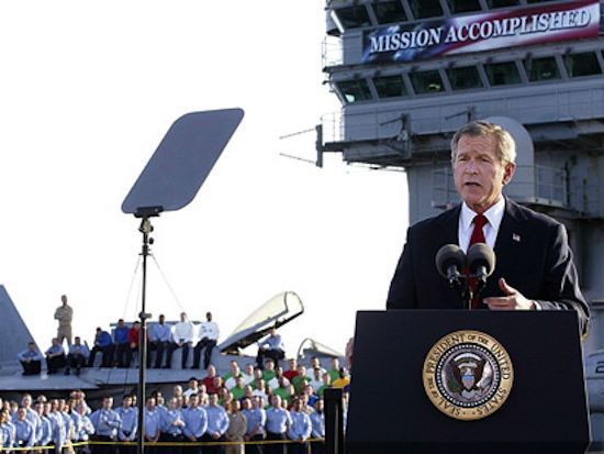 George W. Bush under 'Mission Accomplished' banner on US aircraft carrier Lincoln