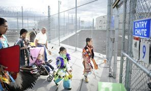 Powwow visitors, including children for the first time in years, enter the state penitentiary in Walla Walla last Tuesday.