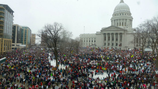 Thousands of people gather outside of the Wisconsin state capital building during the 2011 Wisconsin Budget Protests